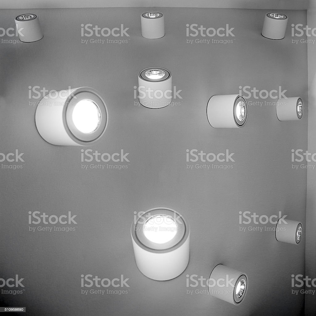 Digital illustration of electric lamps on wall with unusual topology stock photo