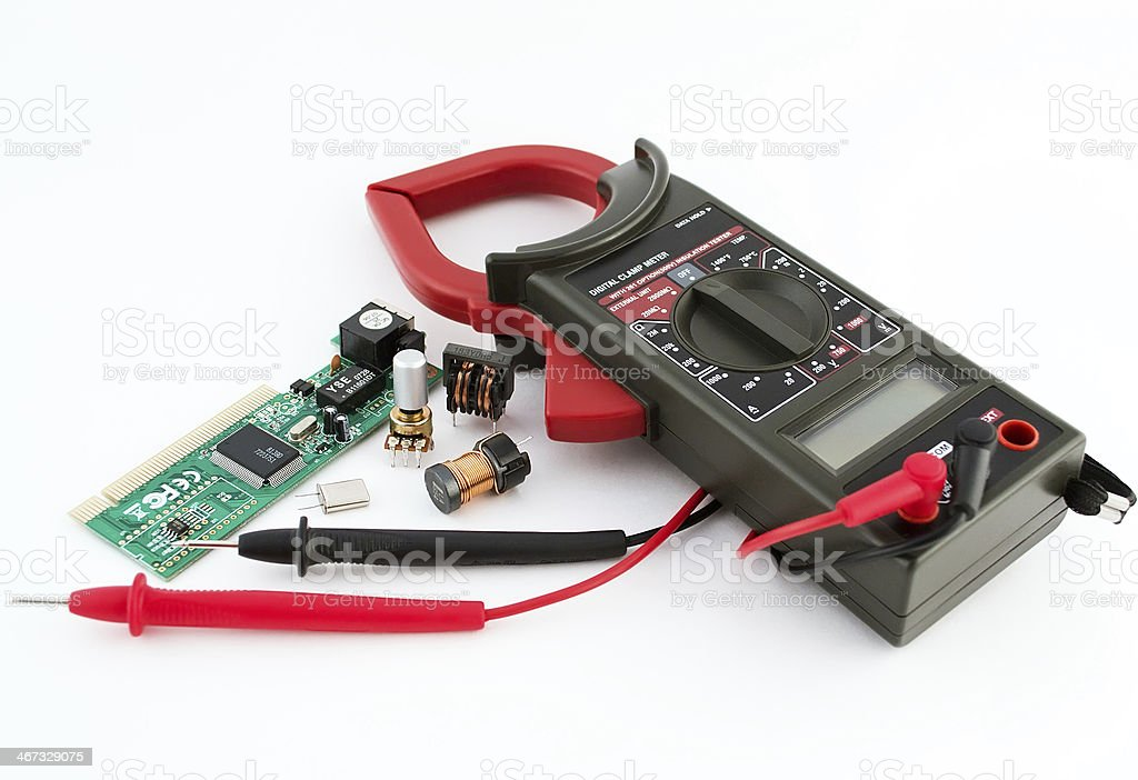 Digital Multimeter and radio components stock photo