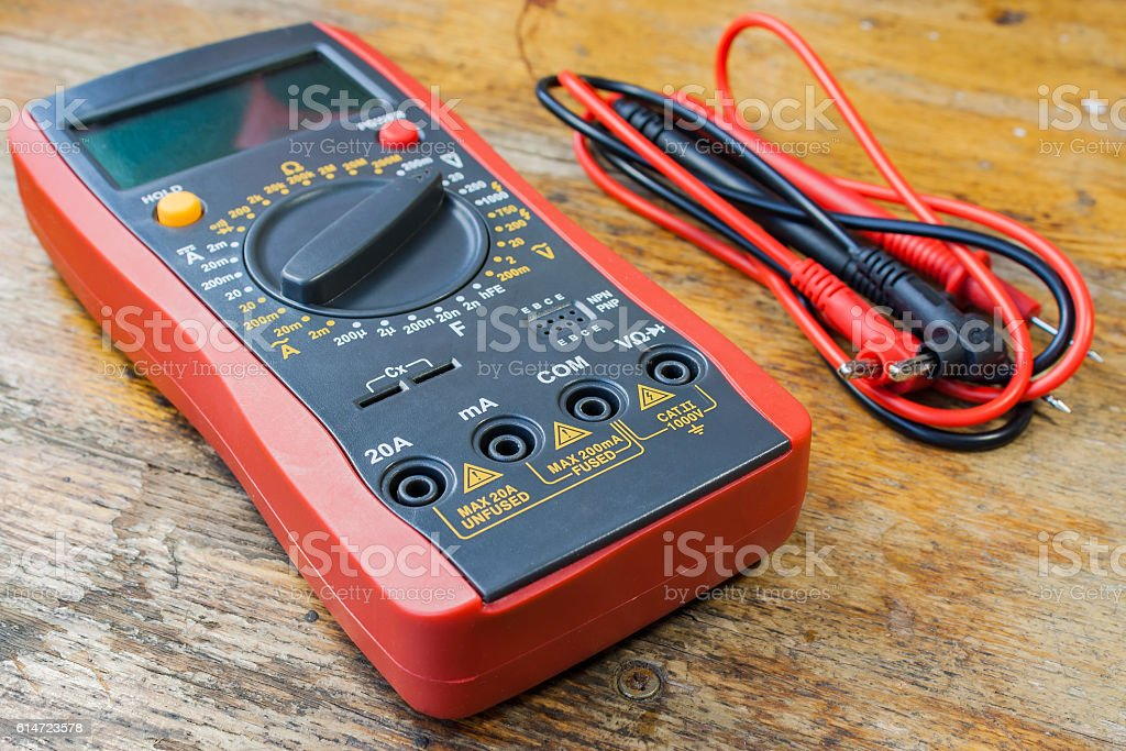 Digital multimeter and set of probes stock photo