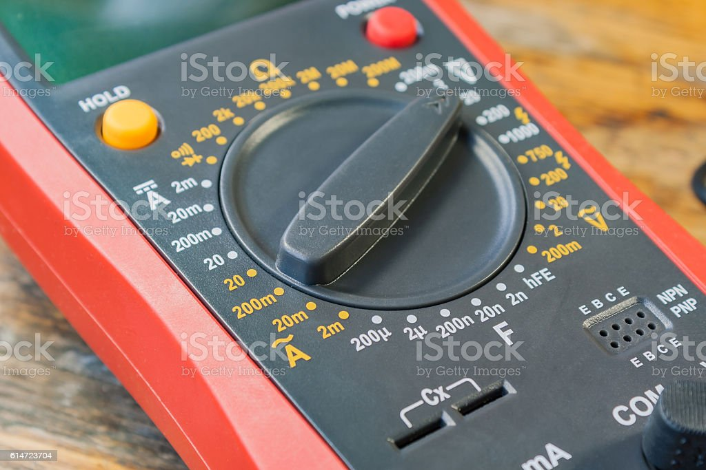 Digital multimeter on a table in a workshop stock photo