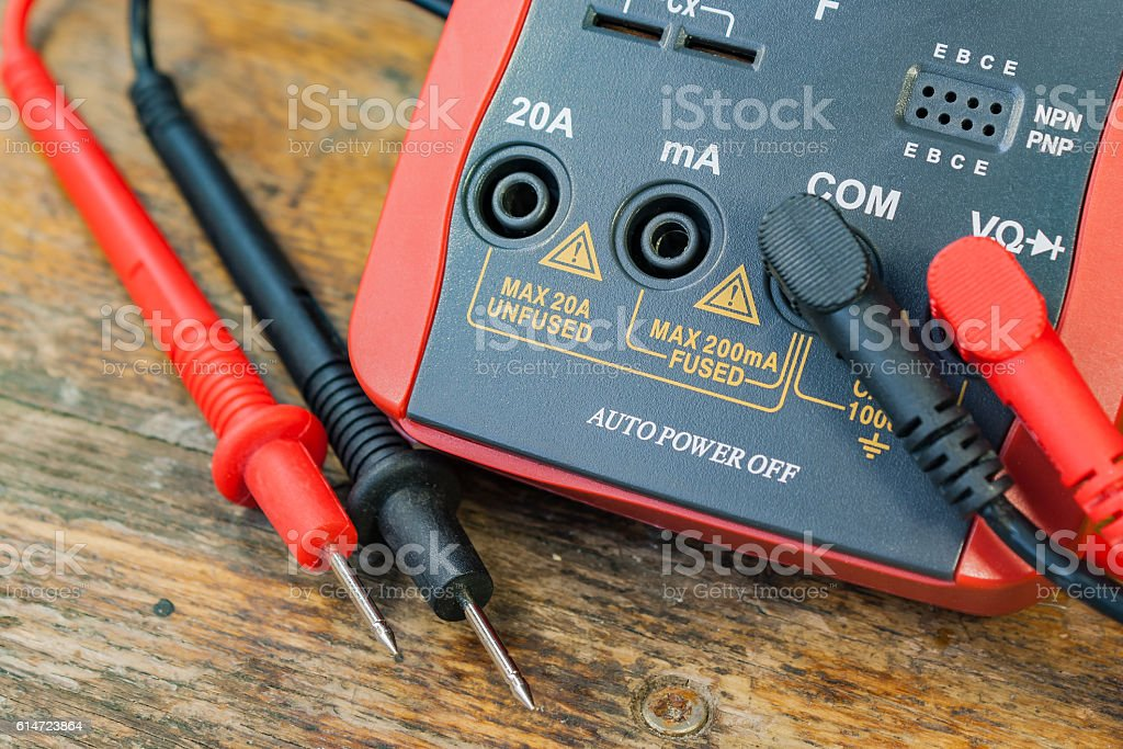 Digital multimeter with the connected probes stock photo