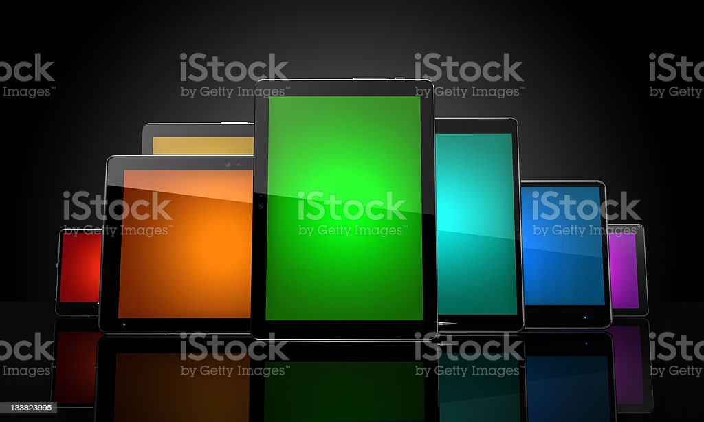 Digital pads with colorful touch screens on black royalty-free stock photo