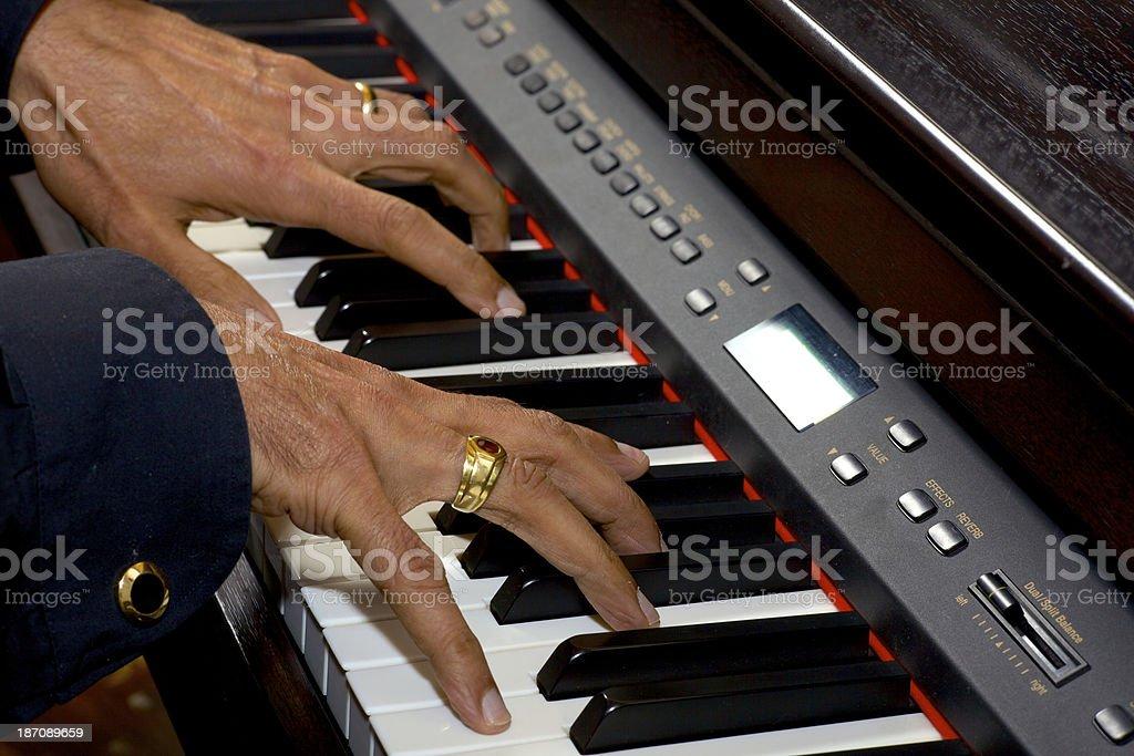 Digital Piano - Asian male fingers on keyboard stock photo