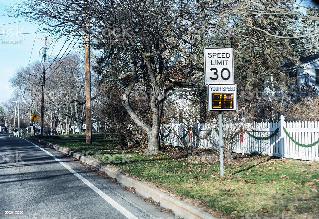 Digital Radar Warning Display On Speed Limit 30 Road Sign stock photo