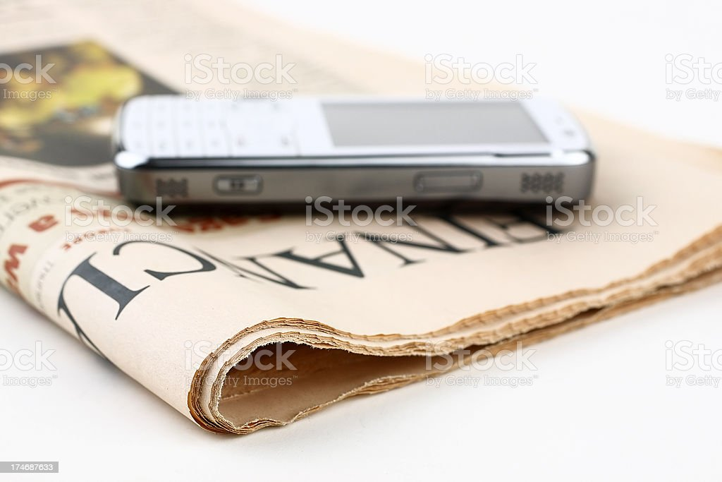 Digital recorder placed on top of a newspaper stock photo