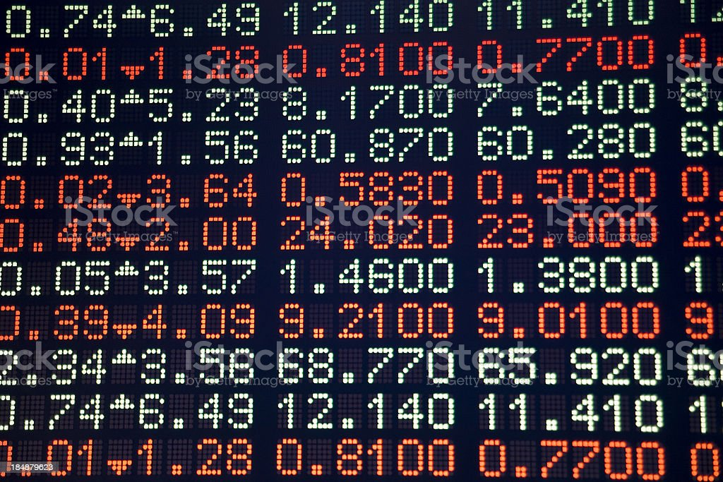 A digital screen showing stock data in red and white stock photo