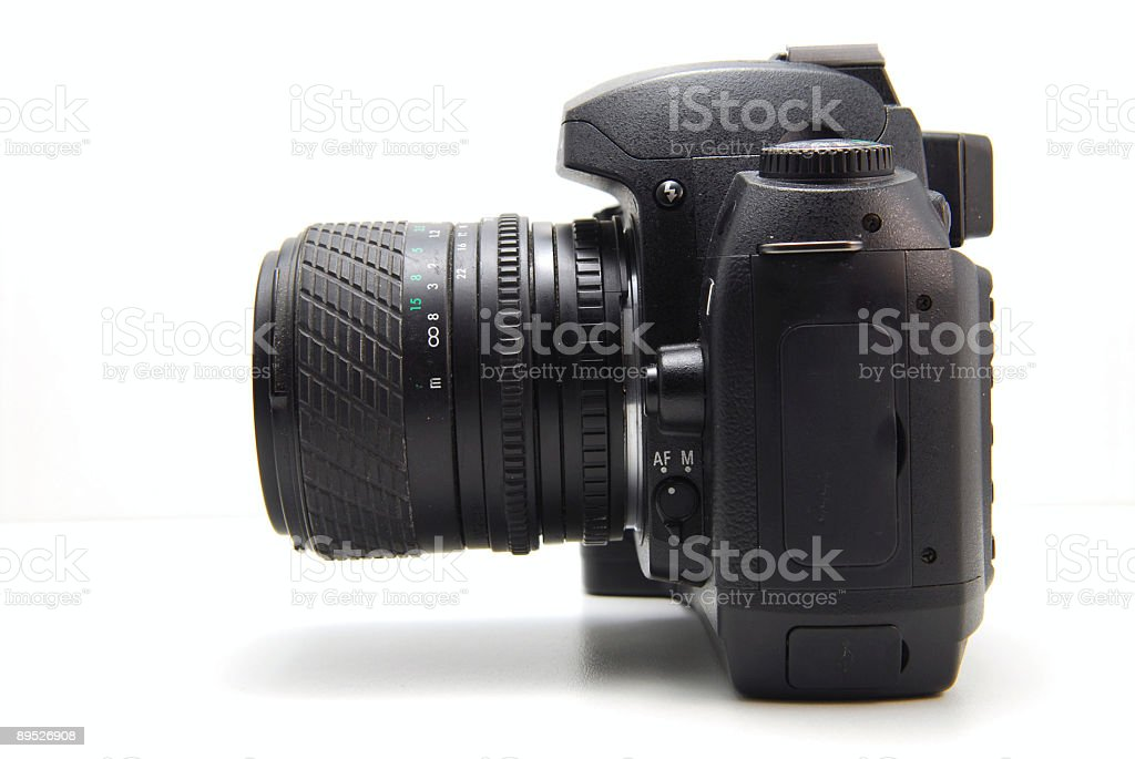 Digital SLR with zoom lens stock photo