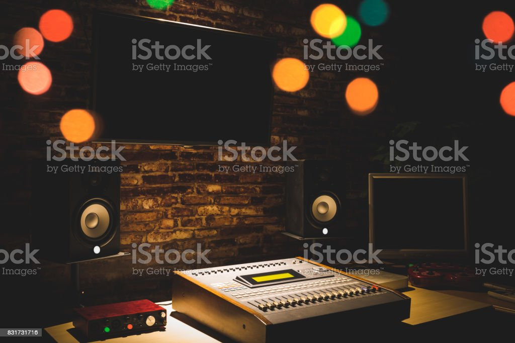 digital sound mixer, monitor speakers & LED screen in recording studio. music production stock photo