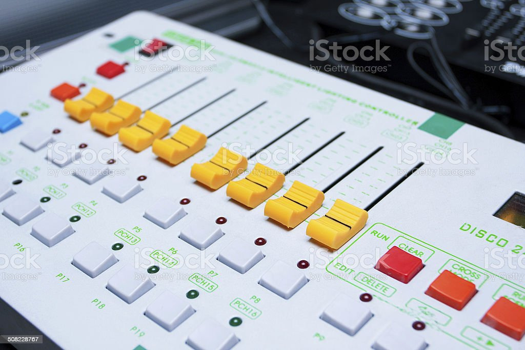 Yellow buttons equipment in audio recording studio of the white...