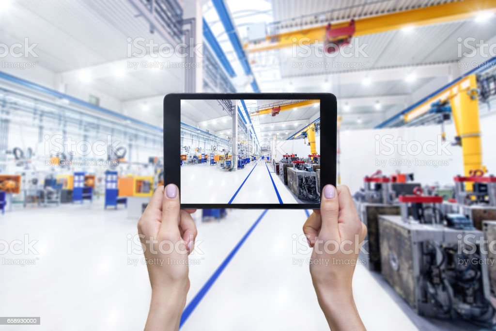 Digital tablet & aisle in factory stock photo