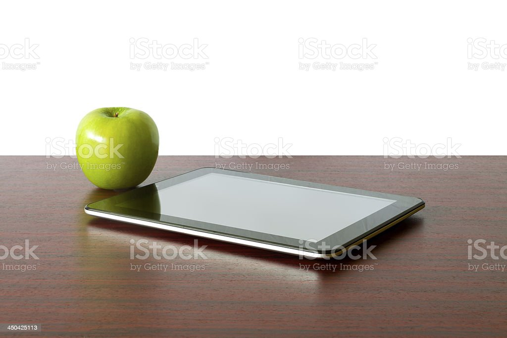 Digital tablet and apple stock photo