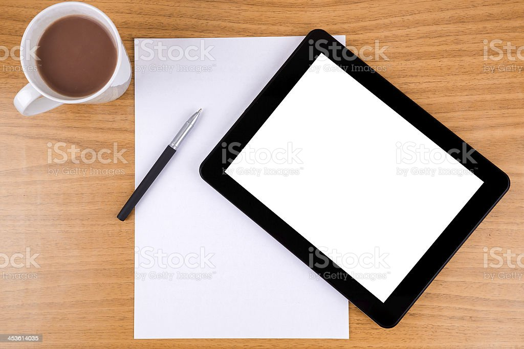 Digital Tablet and blank papers stock photo