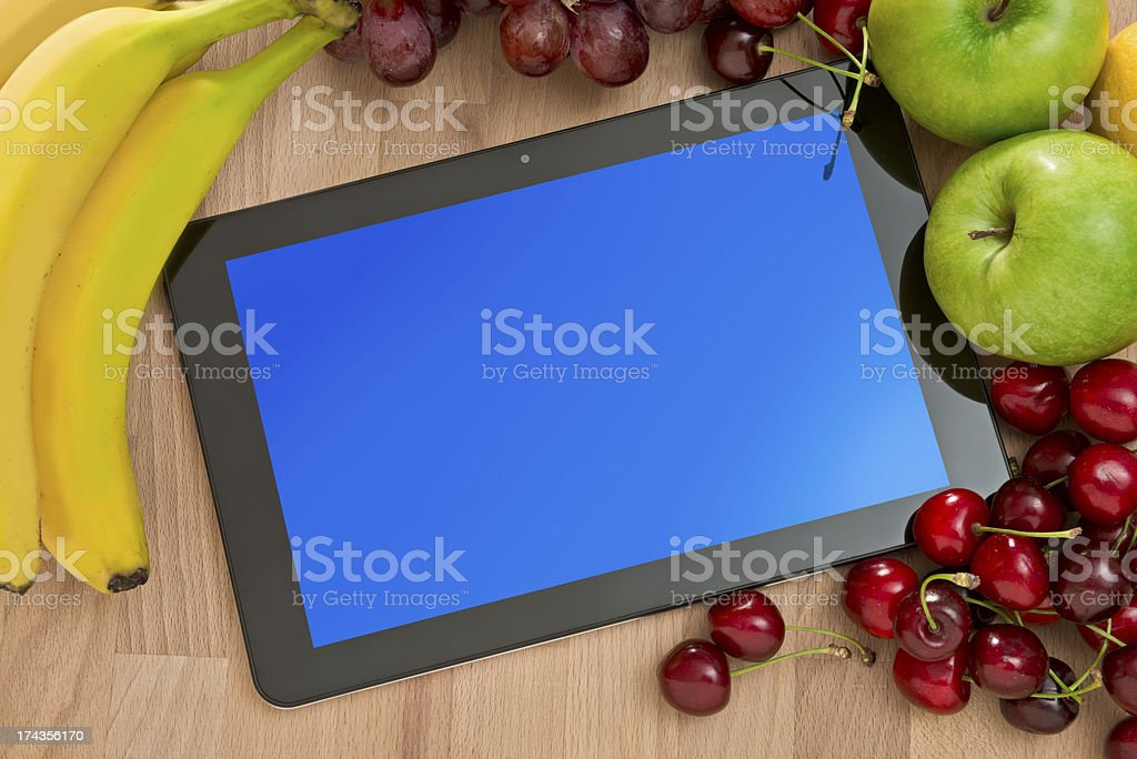 Digital tablet and fresh fruits royalty-free stock photo
