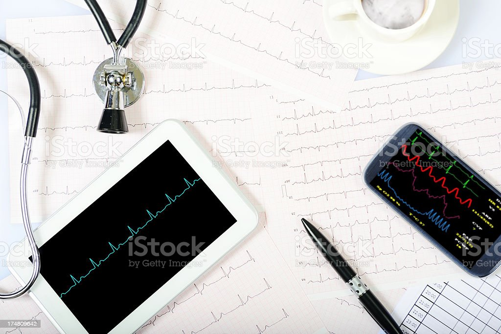 Digital Tablet and Smart Phone with Pulse Trace royalty-free stock photo
