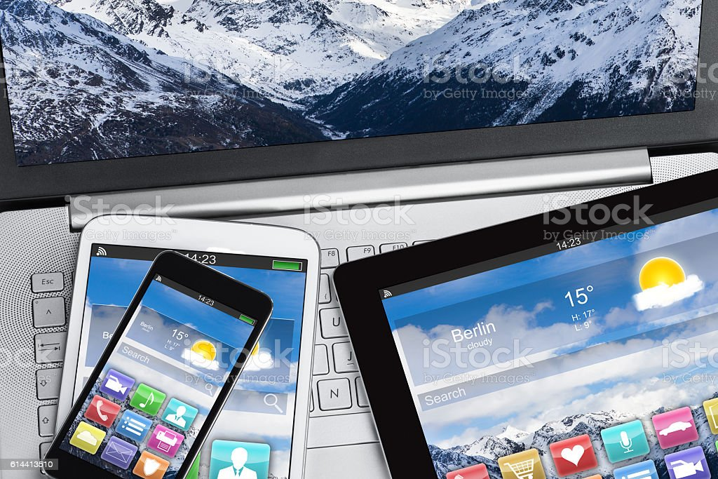 Digital Tablet And Smartphones On Laptop stock photo