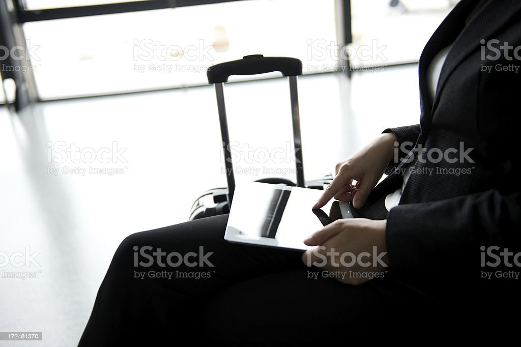 digital tablet at airport royalty-free stock photo
