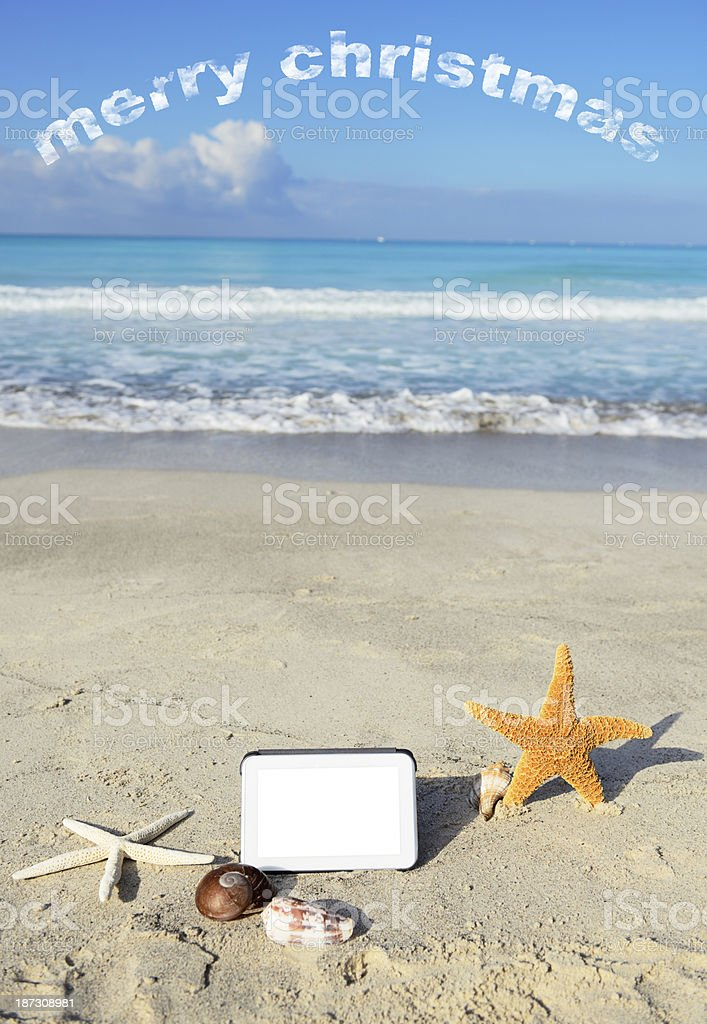 Digital Tablet at the Beach royalty-free stock photo