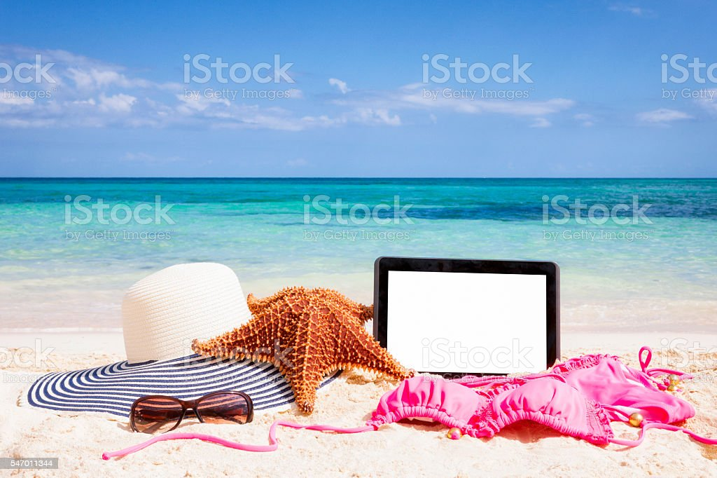Digital tablet computer and beach items in the Bahamas stock photo