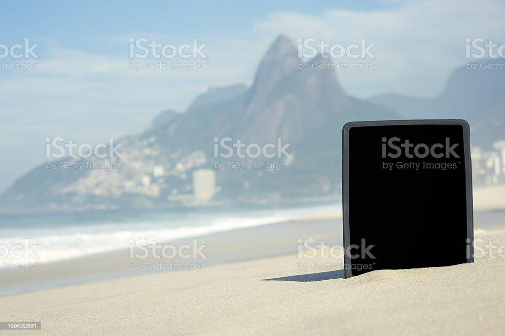 Digital Tablet Computer Stands on Ipanema Beach Rio de Janeiro royalty-free stock photo
