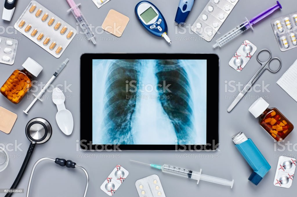 Digital tablet displaying chest X-ray amidst medical supplies stock photo
