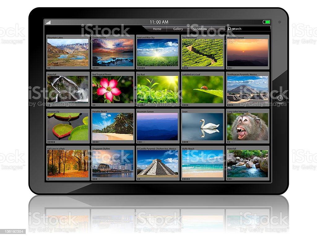 A digital tablet displaying pictures stock photo