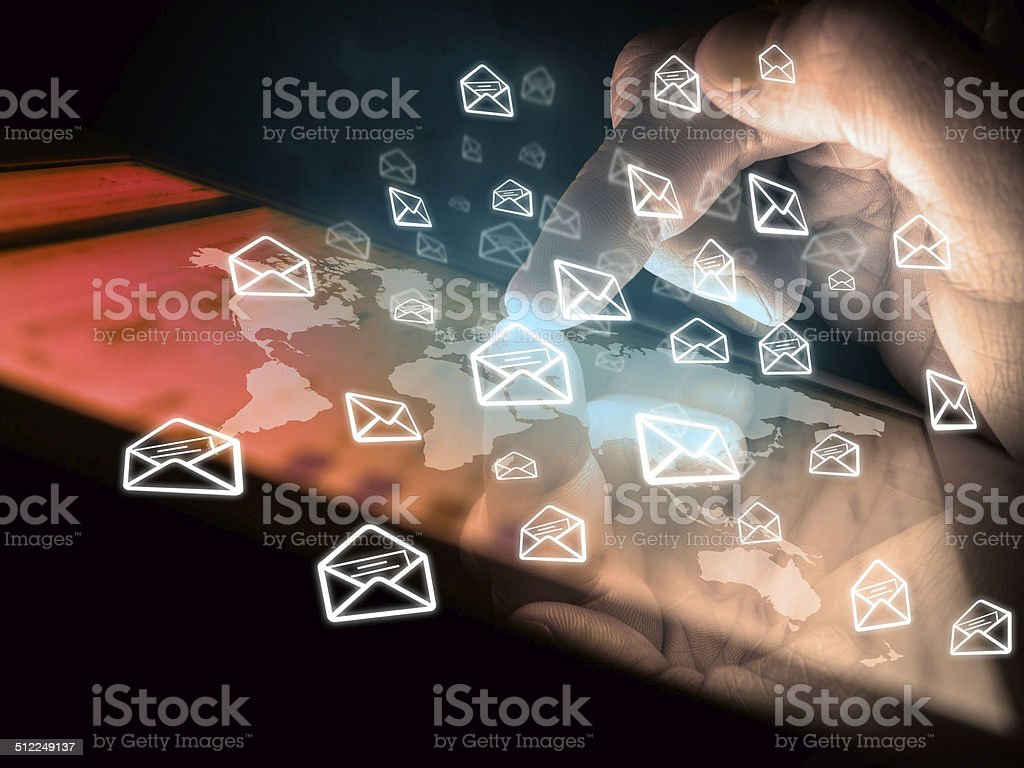 digital tablet in hand and sending e-mails stock photo