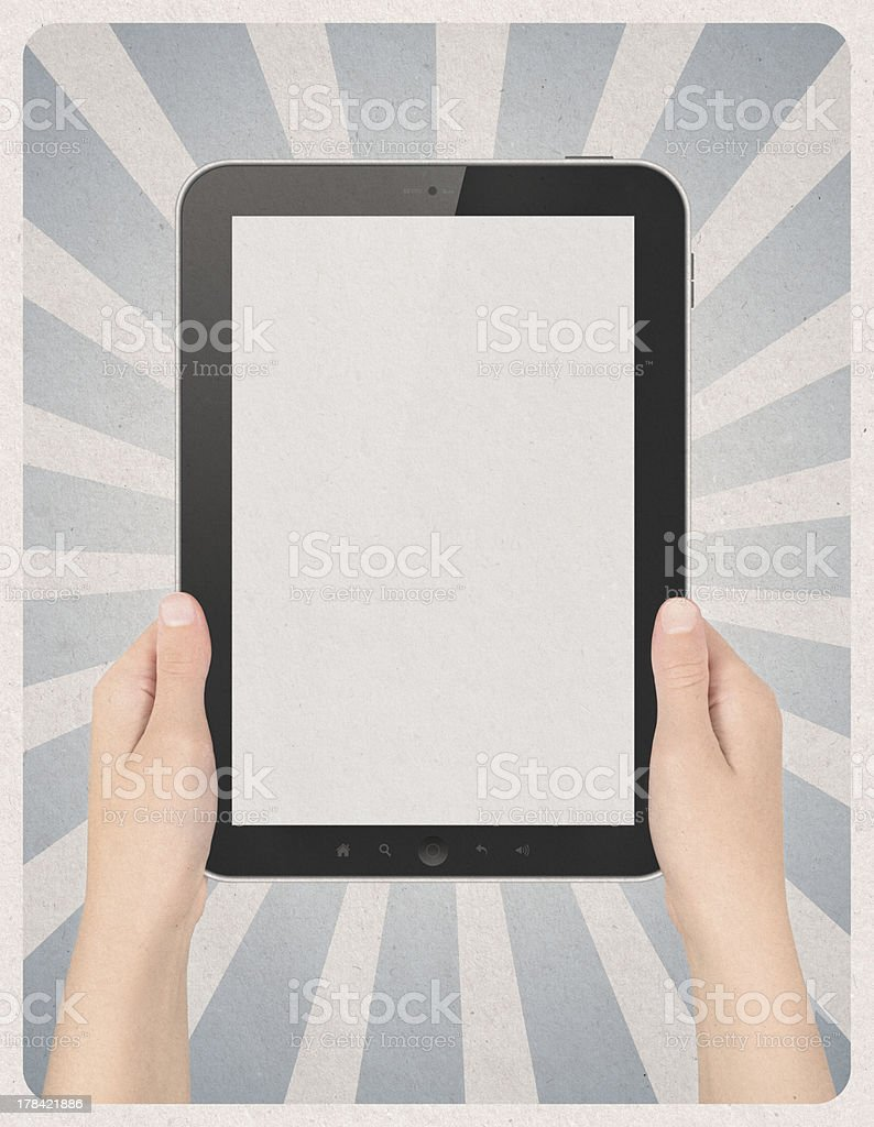 Digital tablet in hands on retro background royalty-free stock photo