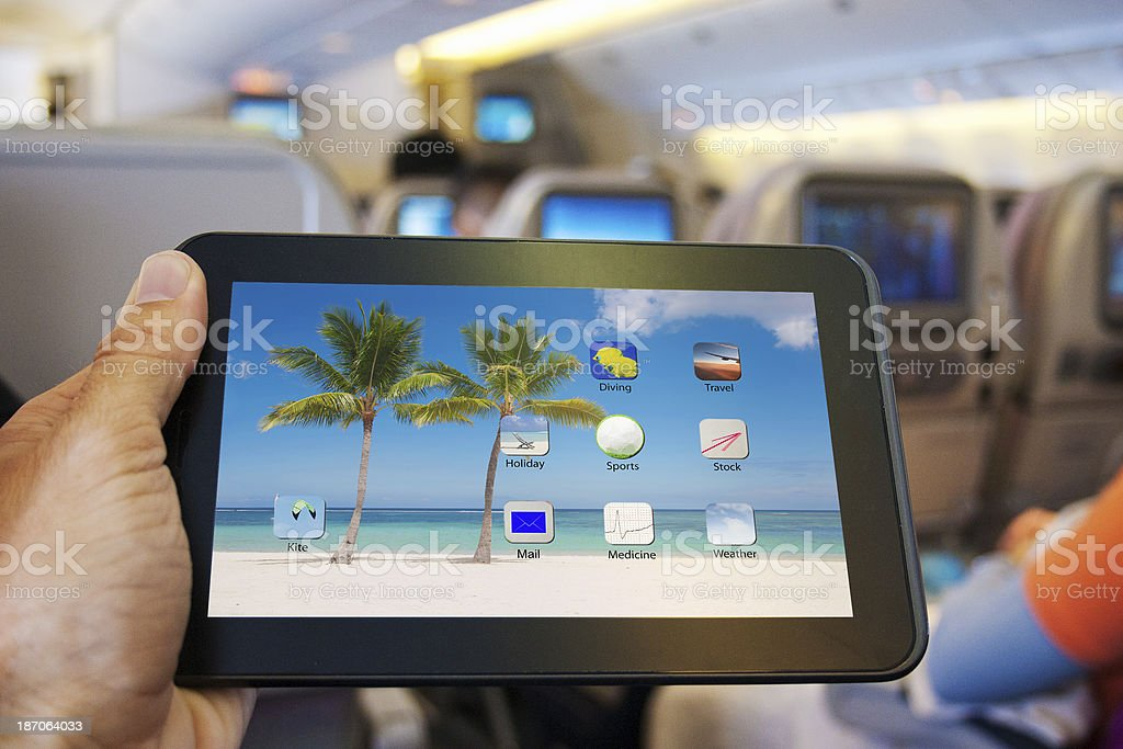 Digital tablet in the plane stock photo