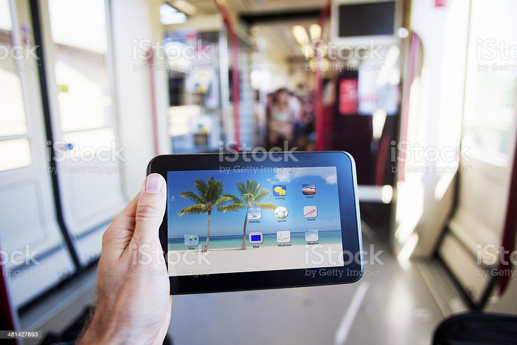 Digital tablet in the train stock photo
