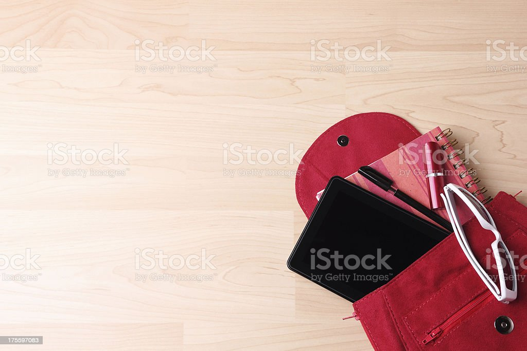 Digital Tablet in  Woman's Bag Backpack stock photo