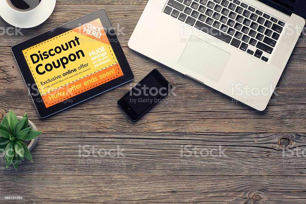 Digital tablet, laptop and smart phone on a wooden table. stock photo