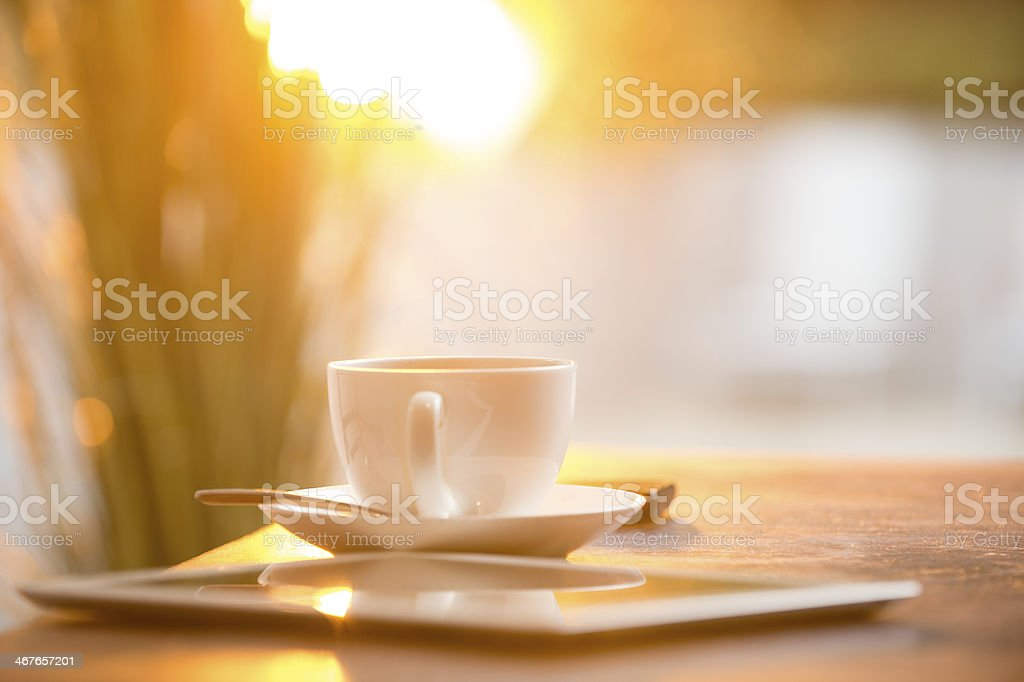 Digital tablet, mobile phone with lens flare. stock photo