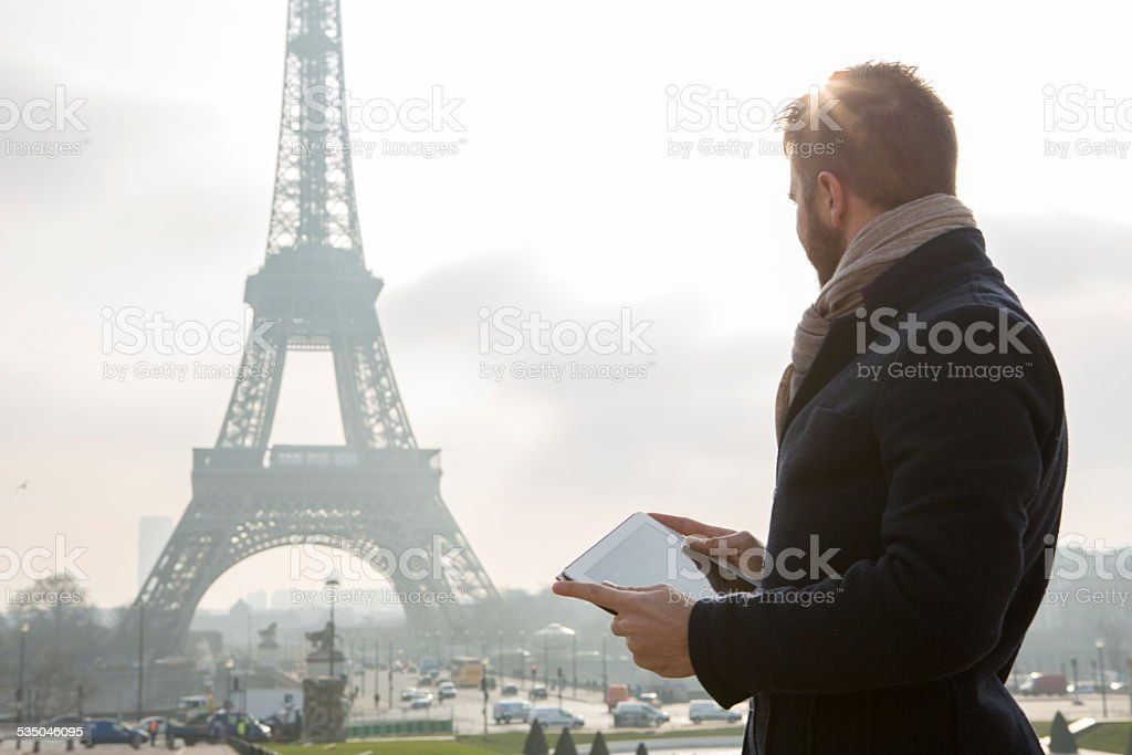 Digital tablet near Eiffel tower-Paris stock photo