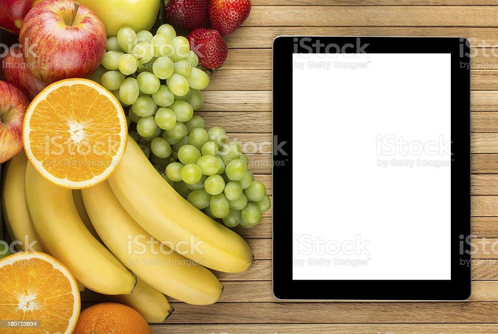 Digital tablet near fresh fruits royalty-free stock photo