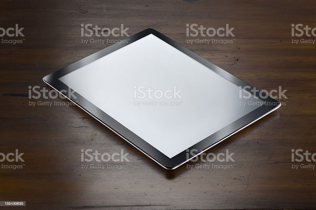 Digital Tablet On Antique Wooden Table.Color Image royalty-free stock photo