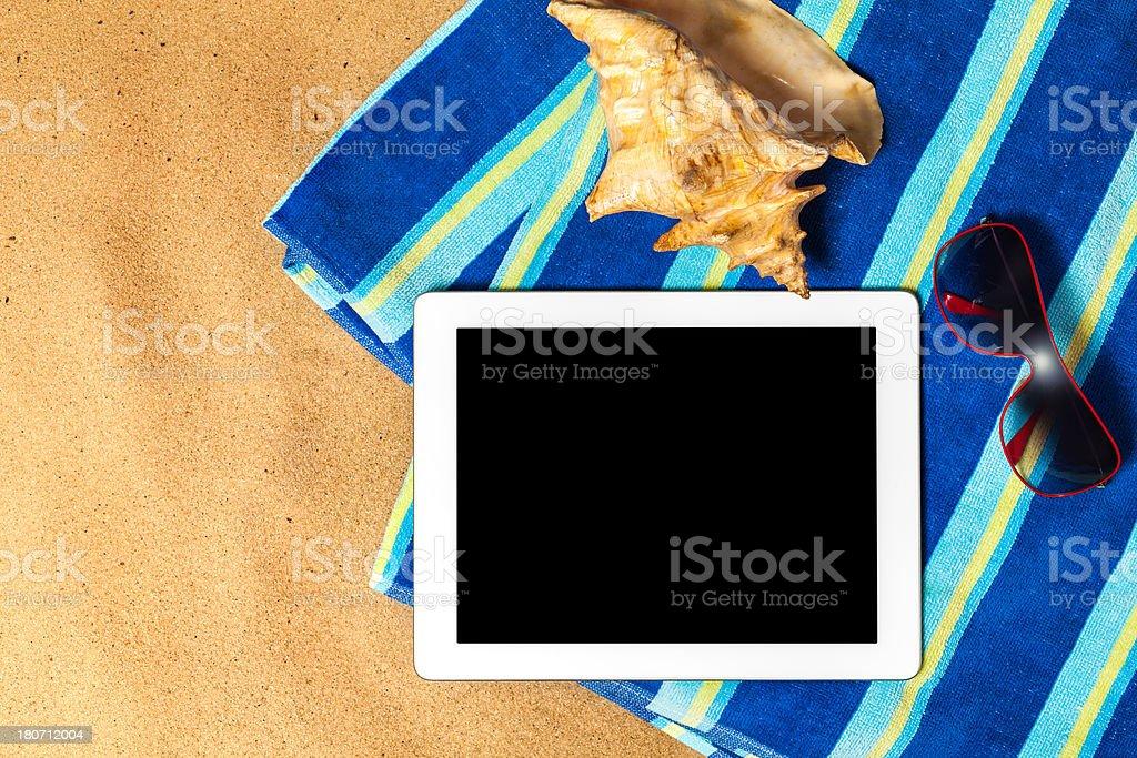 Digital Tablet on beach royalty-free stock photo