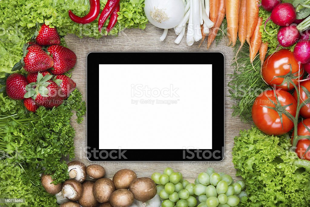 Digital Tablet on cutting board with healthy food royalty-free stock photo
