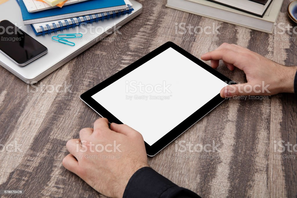 Digital tablet on desk stock photo