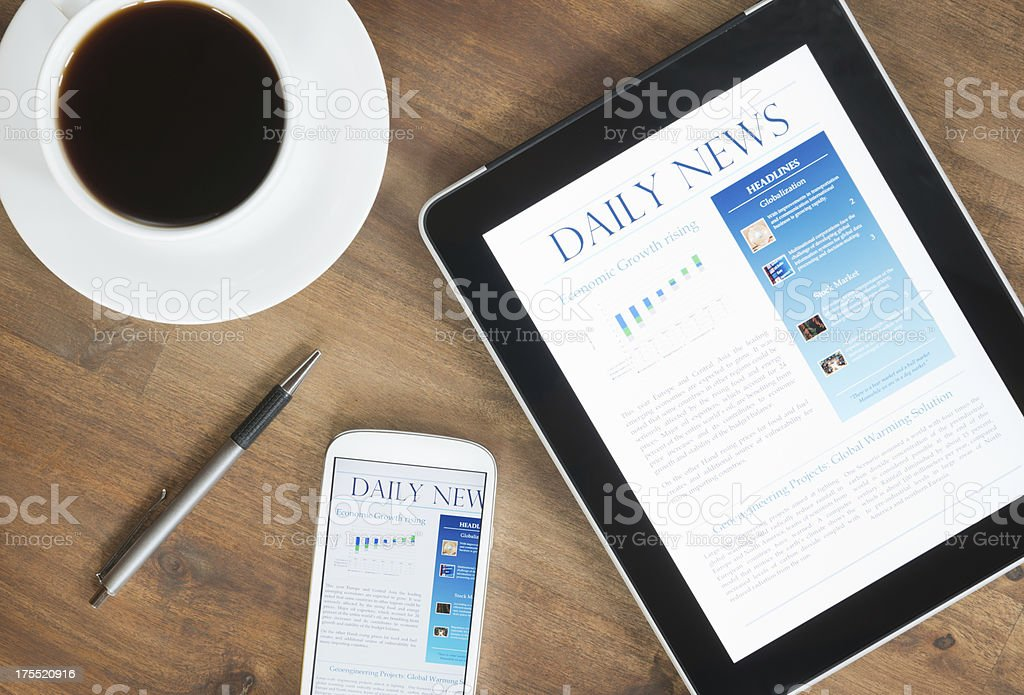 Digital Tablet PC With News On Desk (XXXL) stock photo