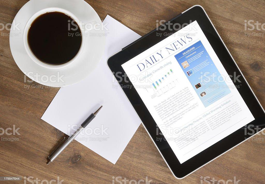 Digital Tablet PC With News On Desk (XXXL) royalty-free stock photo