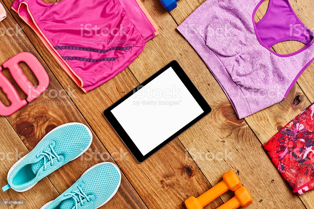Directly above flat lay shot of digital tablet surrounded with...