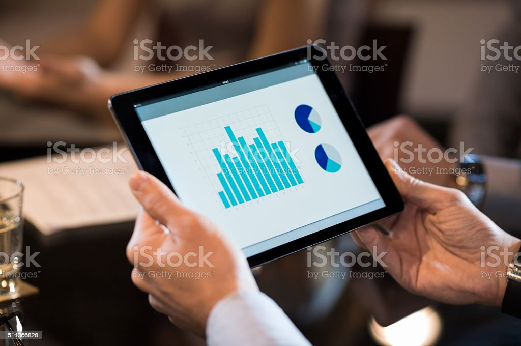 Digital tablet with business chart stock photo