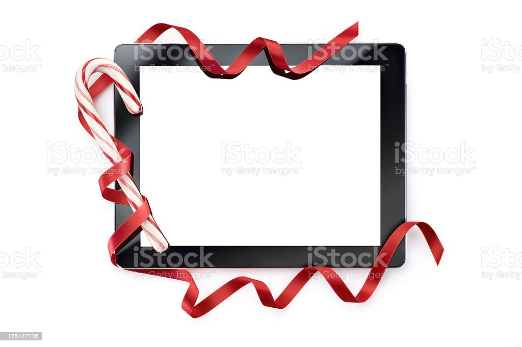 Digital Tablet With Candy Cane And Ribbon.Color Image royalty-free stock photo