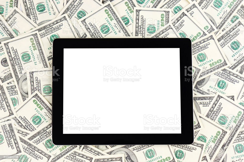 Digital tablet with dollars stock photo