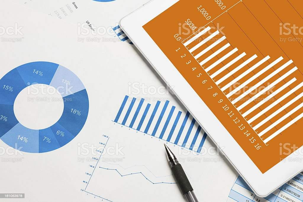 digital tablet with finance report stock photo