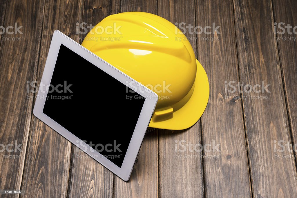 digital tablet with hardhat royalty-free stock photo