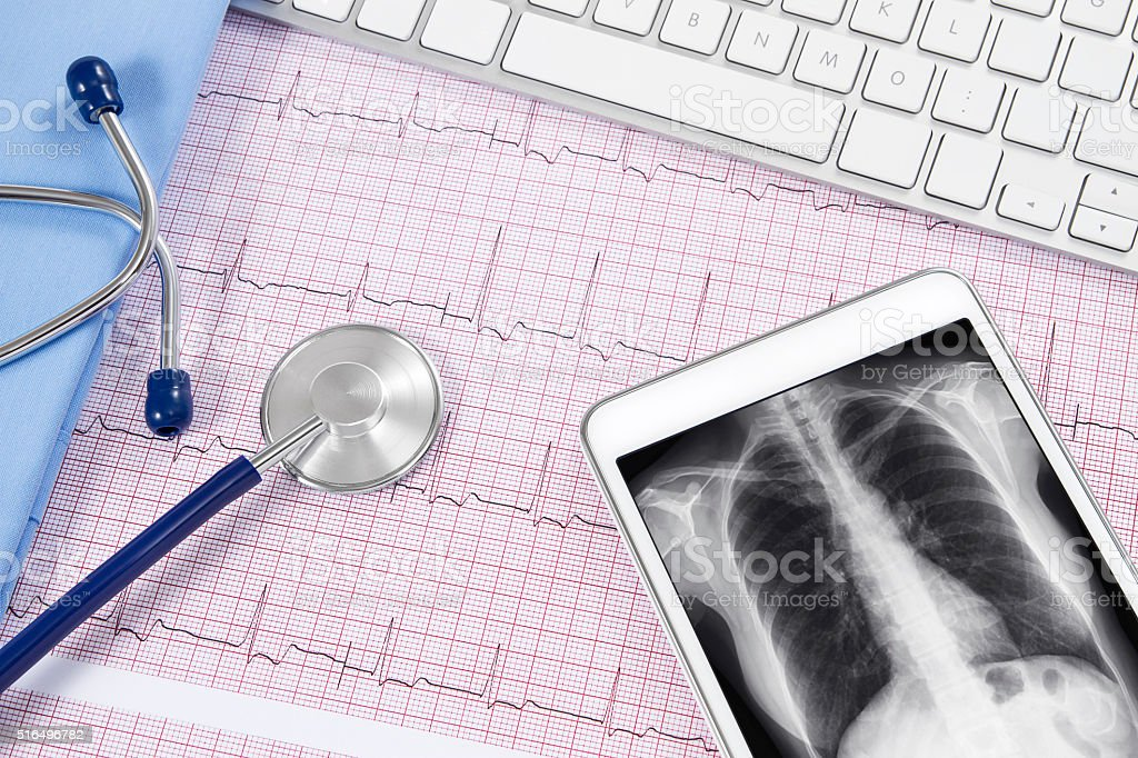 Digital Tablet with Lung X-Ray, Stethoscope and Keyboard stock photo
