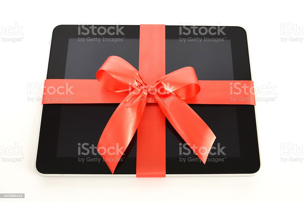 Digital tablet with red ribbon stock photo