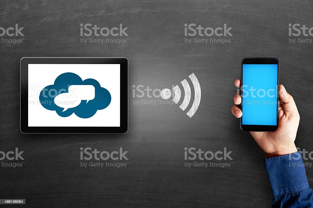 Digital tablet with thought bubbles stock photo