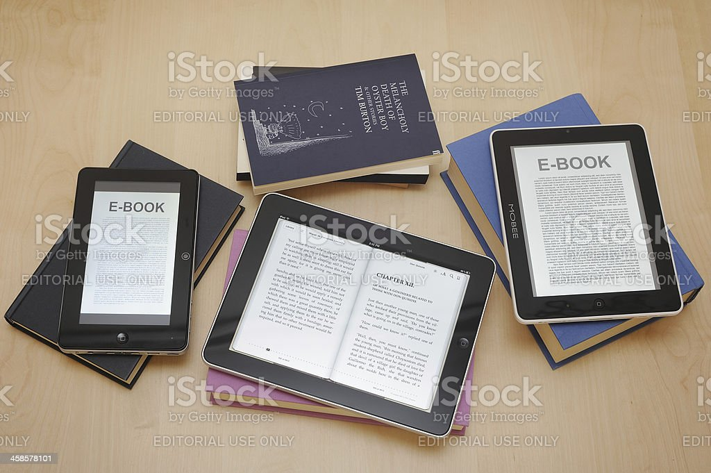 Digital Tablets and e-readers with books royalty-free stock photo